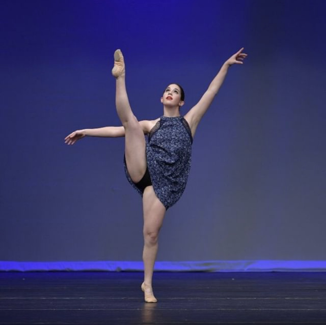 "Senior Lauren Johnson performs her contemporary solo at the Youth America Grand Prix.  Johnson has been doing dance ever since she was little and dreams to perform on Broadway.  ""I've been doing [dance] my entire life and it's an easy way for me to express myself,"" Johnson said."
