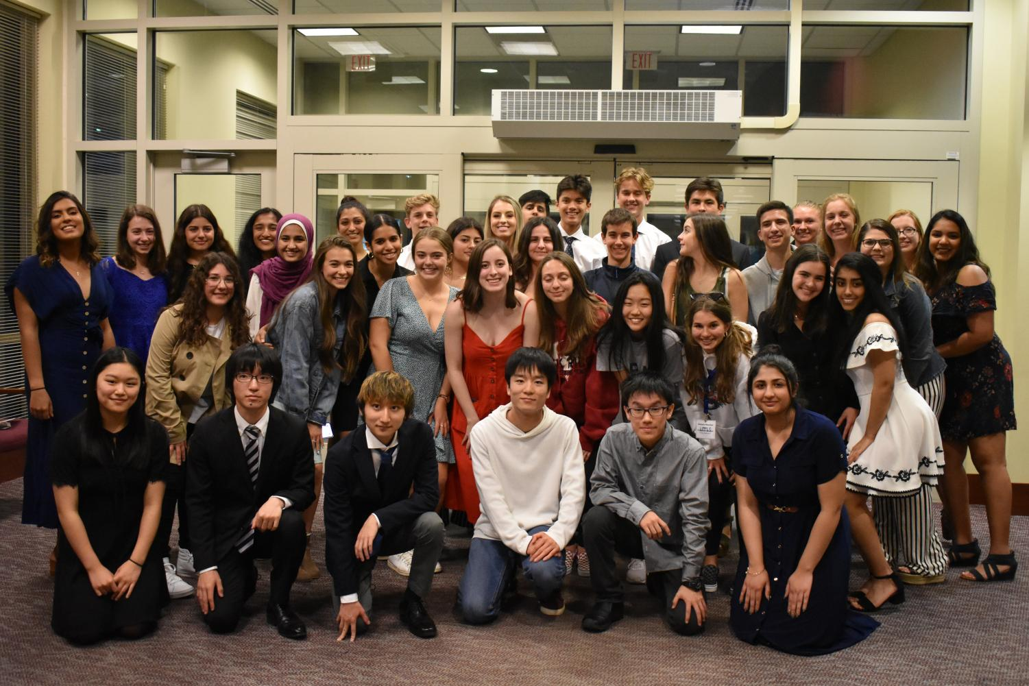 Rock Ridge hosts and delegates gather together at the farewell dinner. (Photo by Rida Ali)