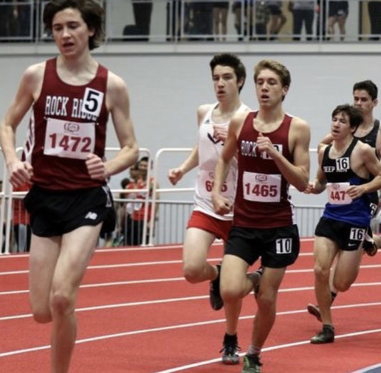 Senior Evan Grace and sophomore Charlie Blundell run the mile at Liberty University's indoor track complex during the Bulldog Invitational meet.