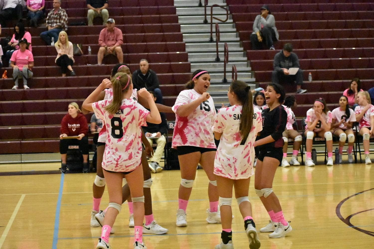 Players freshman Anika Engen, junior Madison Anderson, junior Jayden Thomas, junior Joanelys Santiago, and senior Kiran Patel scream in joy as they score a point. The team made a comeback, scoring several points in a row.