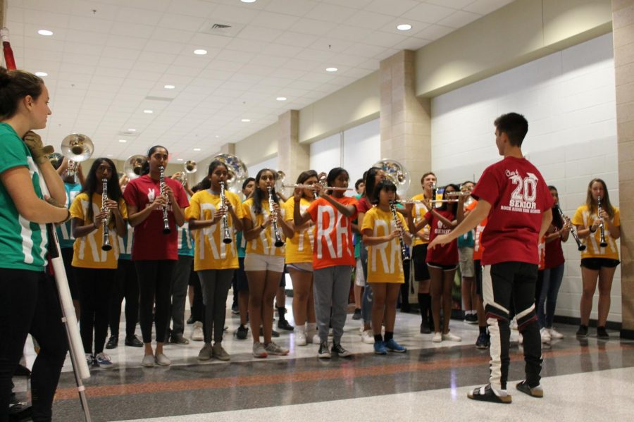 "Marching band performs as students enter the gym for the homecoming pep rally last Friday. The band performed again during the pep rally with color guard. ""I wasn't as nervous because I felt like they would support me no matter what; it was a lot of fun,""  freshman Abhishek Sharma said."