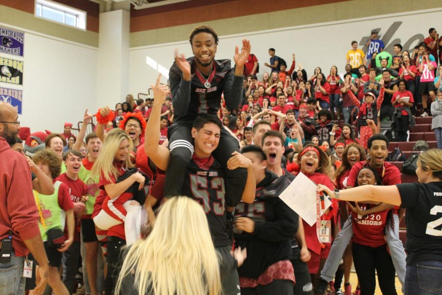Seniors Darius Mayo and Samal Khosravi cheer with their class at the Homecoming pep rally on October 11. The two varsity football players expressed their excitement for the game along with the rest of the senior class to win the spirit stick.