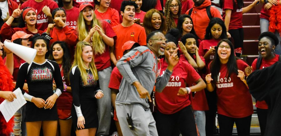 Gregory Spurlock dances with the seniors. The seniors, along with Spurlock, were enjoying DJ Mario's music before the pep rally began on October 11.