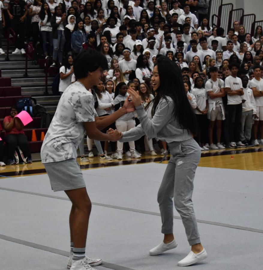 Sophomores Prince Amarante and Christine Choung come out with their handshake during the pep rally. The pair, along with Aakash Mehta, Neha Krishna, Shalom Williams and Alexa Veneros, made up the sophomore homecoming court.