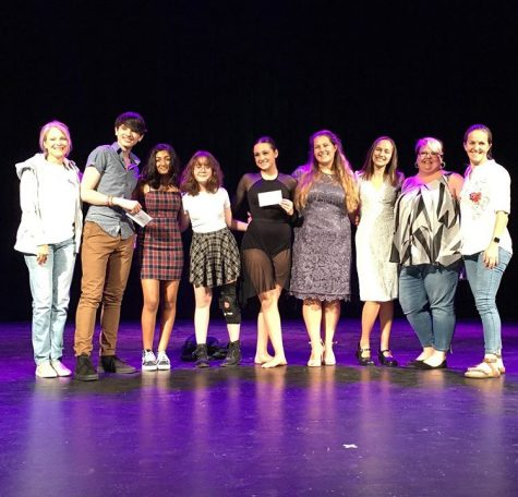 (From left) Social studies teacher Melissa Pruitt, runner up junior Trey Launder, freshman Anna Nguyen and Dhaya Bharath; winners of People's Choice Awards, winner junior Elle Ouimet, along with hosts junior Courtney Bergeron and senior Katie Howard, theater director Katie Rivers and French teacher Veronique Billington, pose for a picture at the end of the talent show.