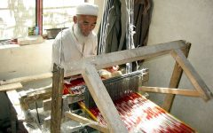 In 2005, an elderly Uyghur man weaves traditional Atlas silk, which is used in Uyghur women's clothing.