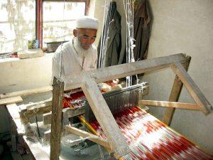 In 2005, an elderly Uyghur man weaves traditional Atlas silk, which is used in Uyghur women's clothing.