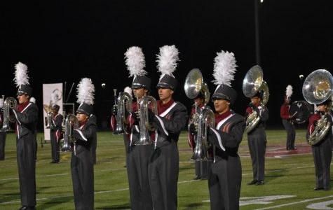 The Marching Band takes the field at the Homecoming Game Friday night during the second half.