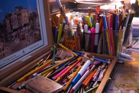 Art supplies pile up in a classroom, in the same way new ideas pile up in the Art Honors Society.