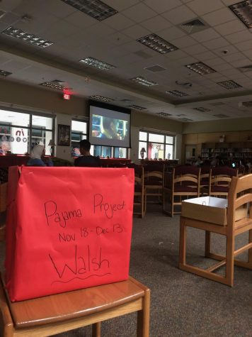 Friends and family gather in the library to participate in the NEHS movie night.