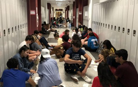 WINGS mentors and freshman students gather around in the hallways discussing their personal and educational interests.