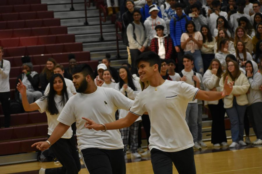 Seniors Vidhi Nangia and Ishmeet Mokoraj along with sophomore Naumeet Manaraj dance to a pop music mix. They used synchronization to their advantage when using both trendy and Bhangra dances, the latter being a type of Punjabi dance.