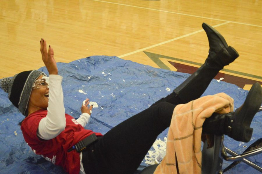 Assistant principal Dawn Dickerson falls out of her chair after being pied in the face by a student. Dickerson was all smiles as the students and faculty shared a laugh about the fun moment.