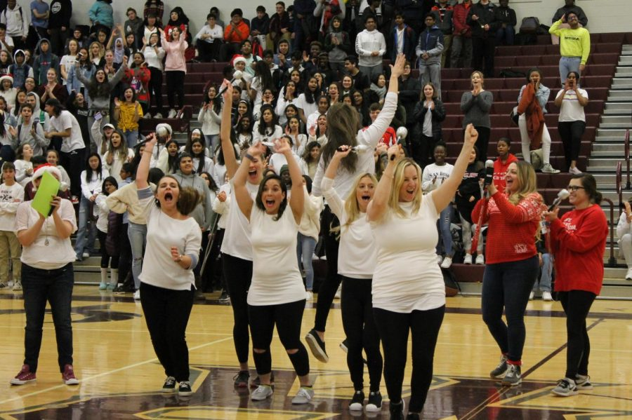 The ecstatic English department raise their sparkly mics in celebration as they are announced as the winners of the lip-syncing competition. Their hair tosses and checking their nails gained them the support of the students in order to obtain their victory.