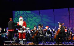 """Santa Claus, portrayed by science teacher Everette Callaway, narrates """"Twas the Night Before Christmas,"""" accompanied with sound effects."""