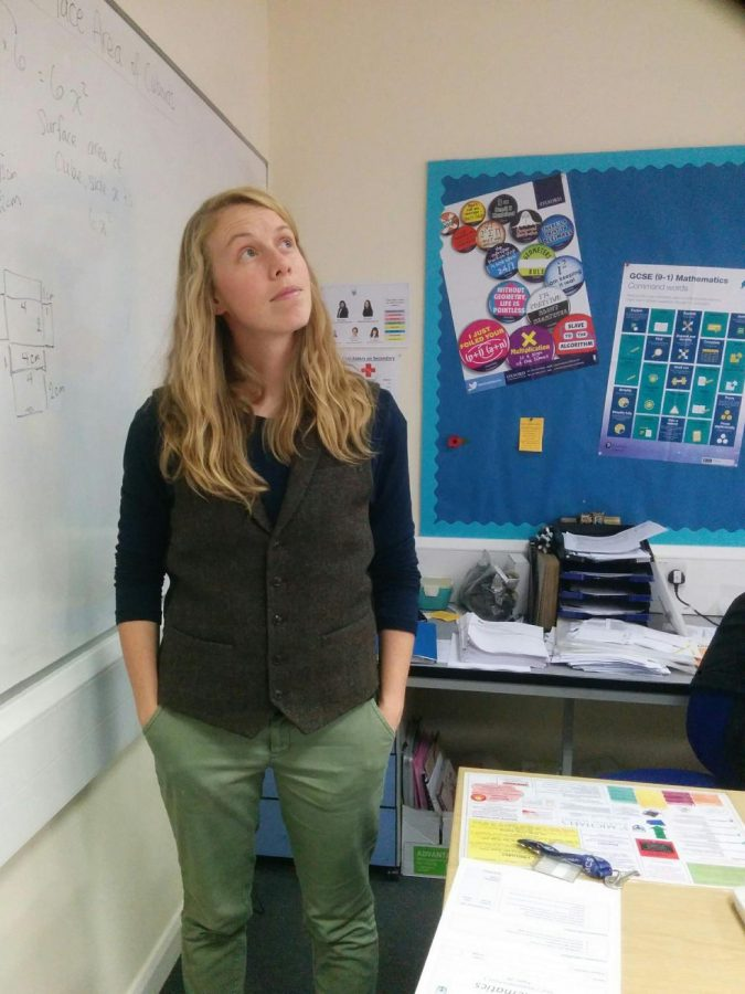 Math+Teacher+Nicole+Turner+poses+for+a+photo+while+teaching+in+her+old+classroom.