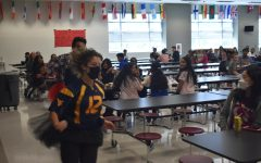 """During lunch on September 15, participants in daily """"lunch games"""" for the week were asked to compete in a relay race around the cafeteria while wearing a tutu, with the winner of the race earning spirit points for their grade. Junior Gina Daly (front) and senior Yasser Mengaoui (back) came in first and second place, respectively. """"The trash can blocked me,"""" Mengaoui said after the race. """"Otherwise, I would've won."""""""